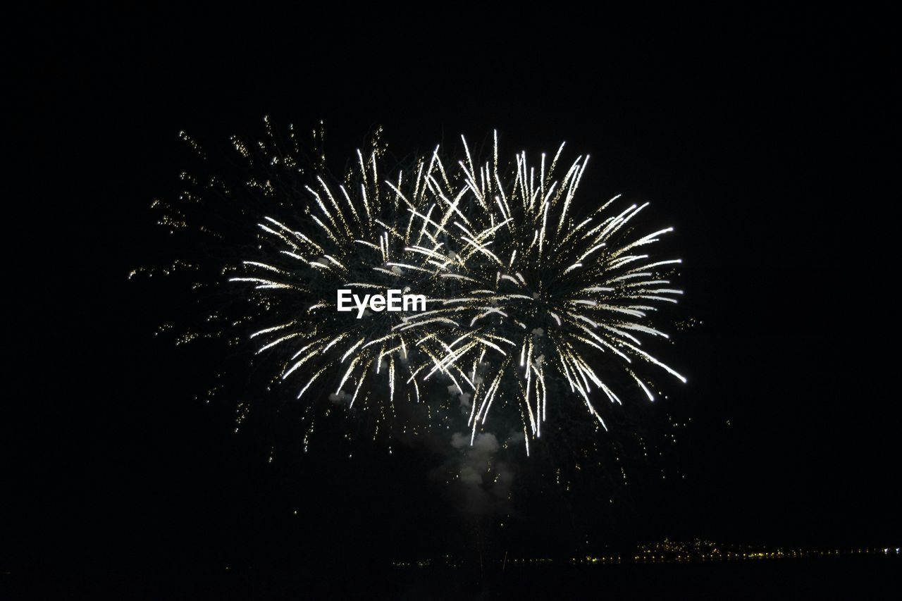 firework display, celebration, firework - man made object, night, exploding, event, long exposure, sparks, low angle view, arts culture and entertainment, glowing, motion, firework, outdoors, blurred motion, sky, no people, illuminated, clear sky