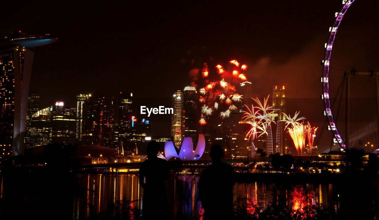 illuminated, night, sky, building exterior, built structure, architecture, outdoors, city, celebration, no people, firework display, multi colored, cityscape, water
