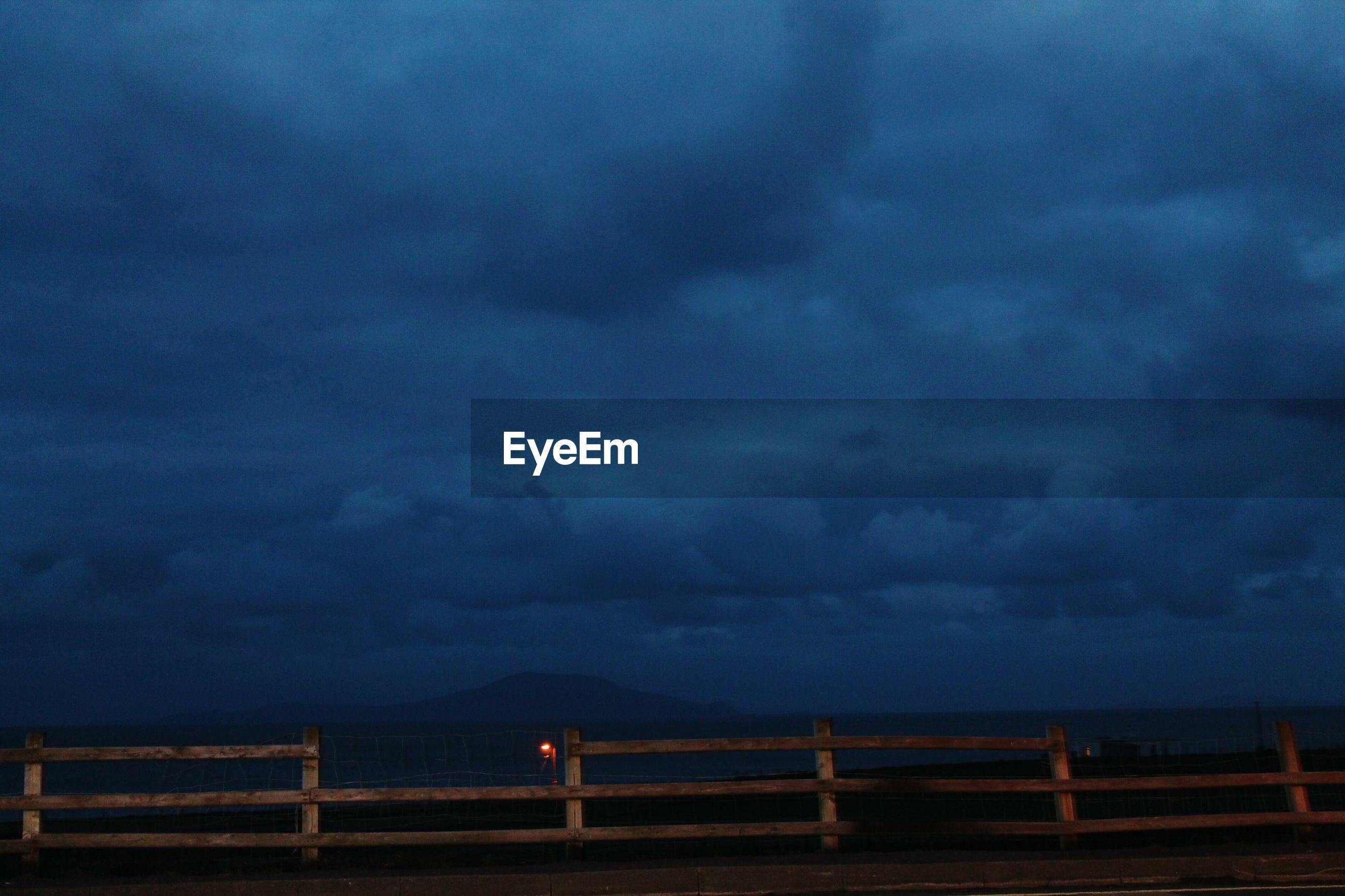 sky, cloud - sky, cloudy, tranquility, weather, scenics, tranquil scene, beauty in nature, storm cloud, overcast, nature, dusk, cloud, railing, dramatic sky, idyllic, cloudscape, landscape, outdoors, atmospheric mood