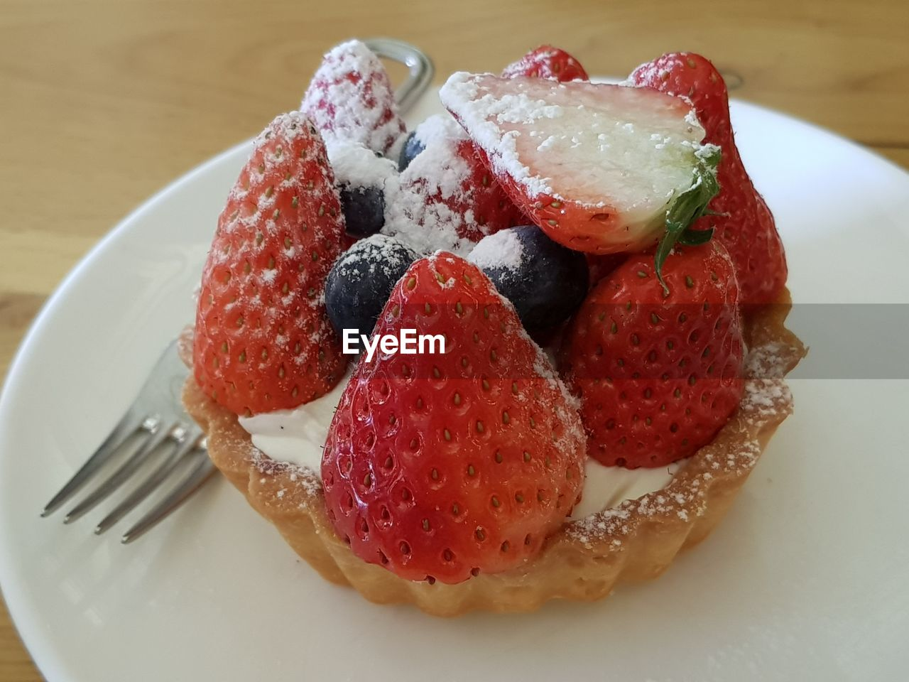 food and drink, food, berry fruit, sweet food, freshness, plate, dessert, fruit, sweet, strawberry, still life, temptation, indulgence, ready-to-eat, fork, close-up, eating utensil, healthy eating, indoors, cake, no people, tart - dessert, ripe, snack, fruitcake
