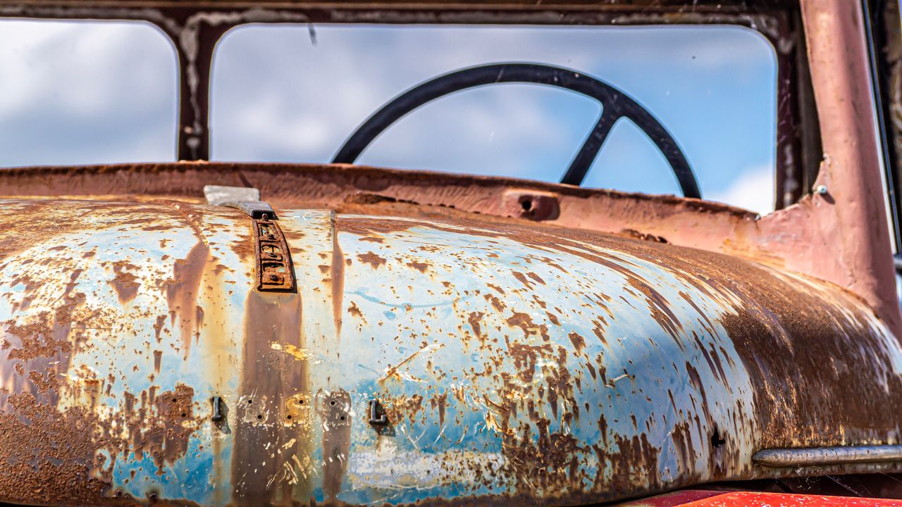 rusty, metal, old, abandoned, car, obsolete, mode of transportation, motor vehicle, land vehicle, no people, damaged, run-down, transportation, weathered, decline, deterioration, day, bad condition, sky, vehicle interior, outdoors, ruined, junkyard