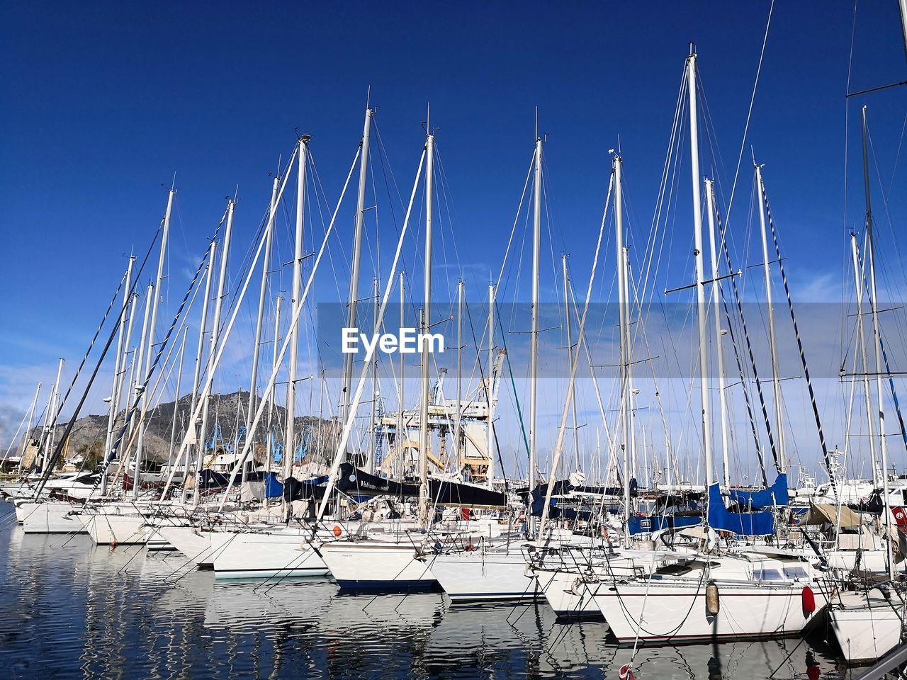 nautical vessel, transportation, mode of transportation, sailboat, water, moored, pole, mast, harbor, no people, day, sky, nature, sea, blue, clear sky, outdoors, abundance, yacht, marina, port