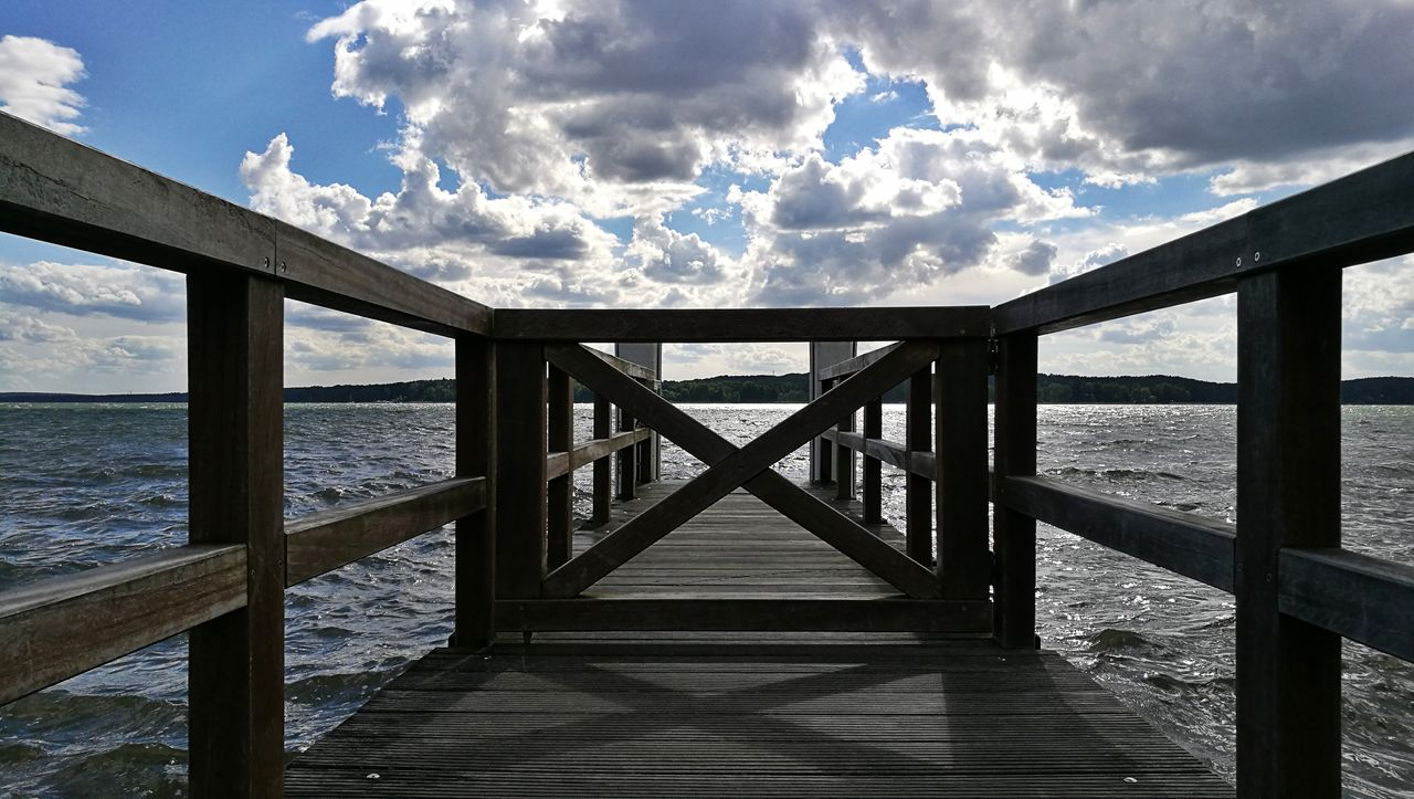 sea, water, pier, wood - material, sky, cloud - sky, railing, nature, day, sunlight, no people, tranquility, jetty, shadow, built structure, scenics, outdoors, horizon over water, beauty in nature, wood paneling, architecture