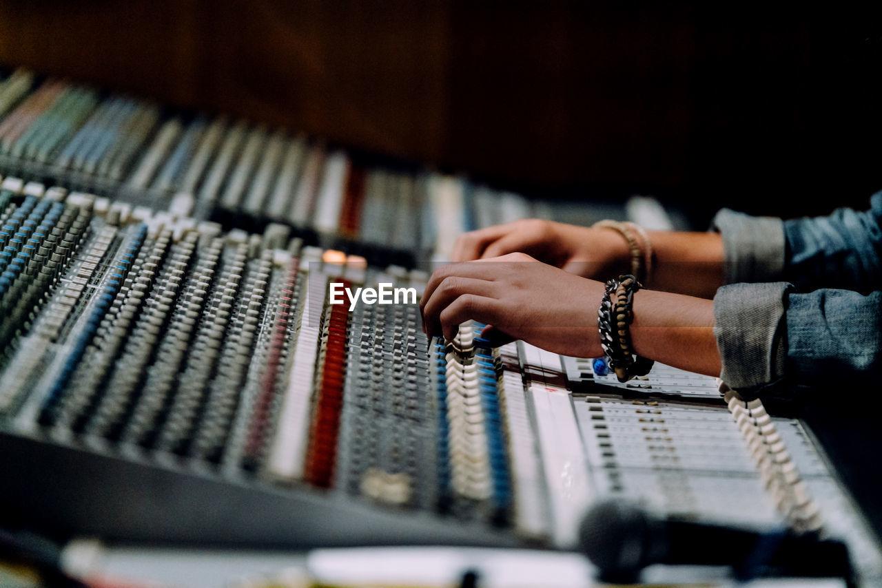 Close-up of hand operating sound mixer