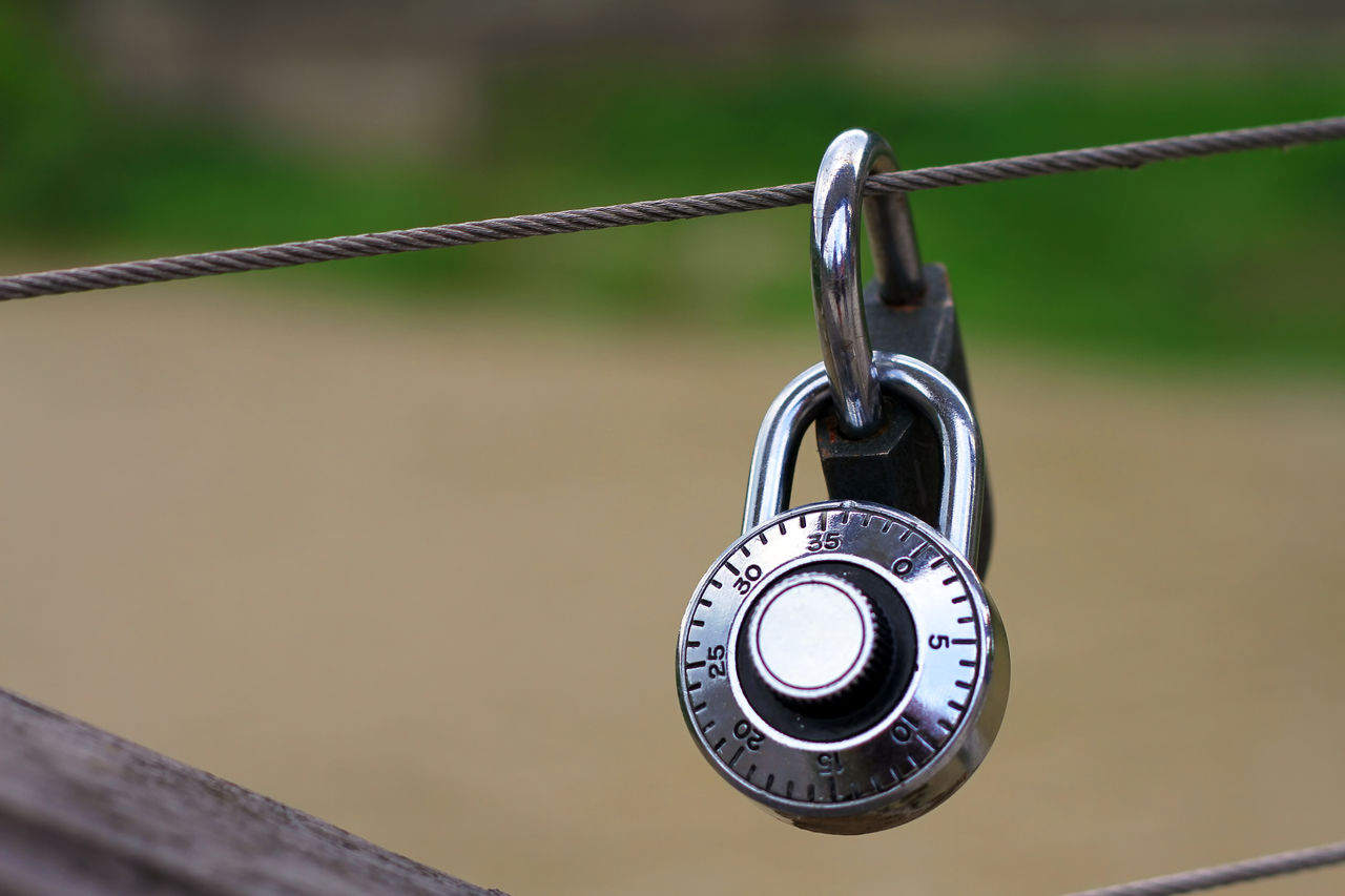 Close-up Of Padlock Hanging On Steel Rope