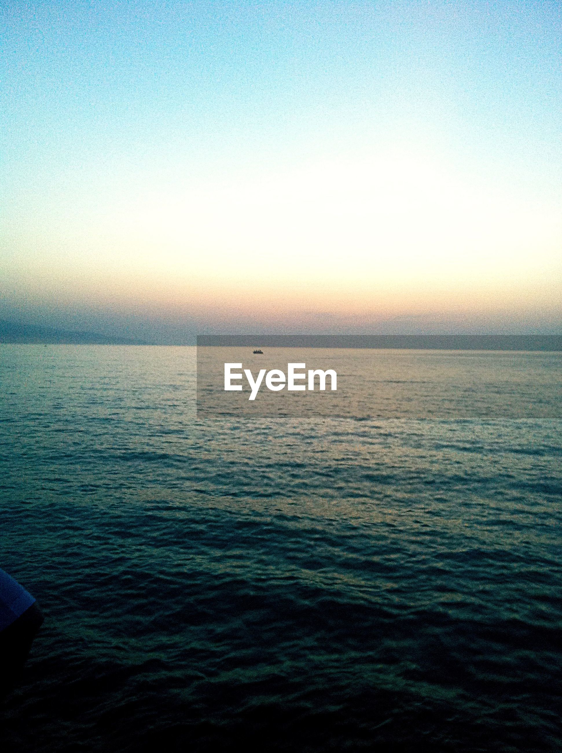 Rowboat in sea at dusk