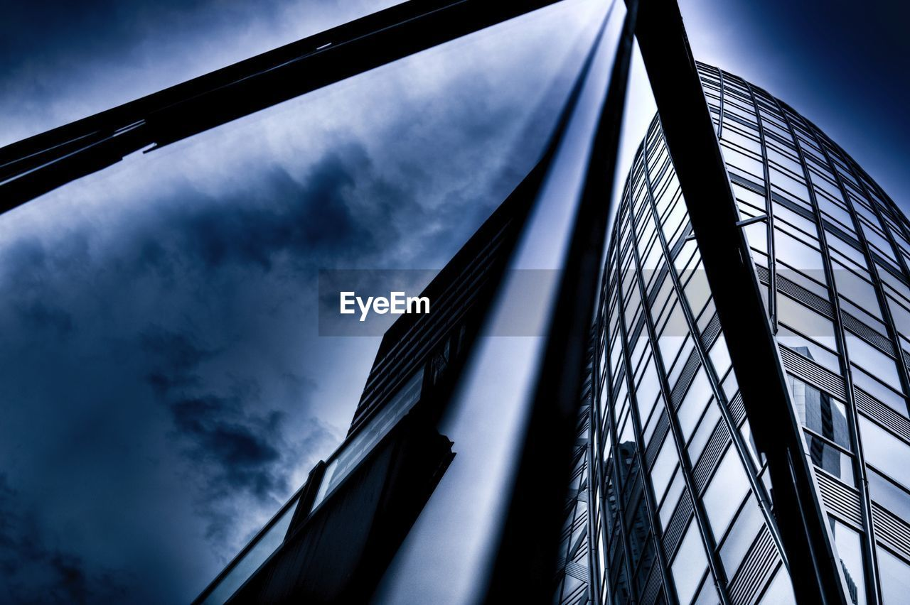 low angle view, sky, architecture, no people, built structure, outdoors, day, cloud - sky, skyscraper, modern, building exterior, city
