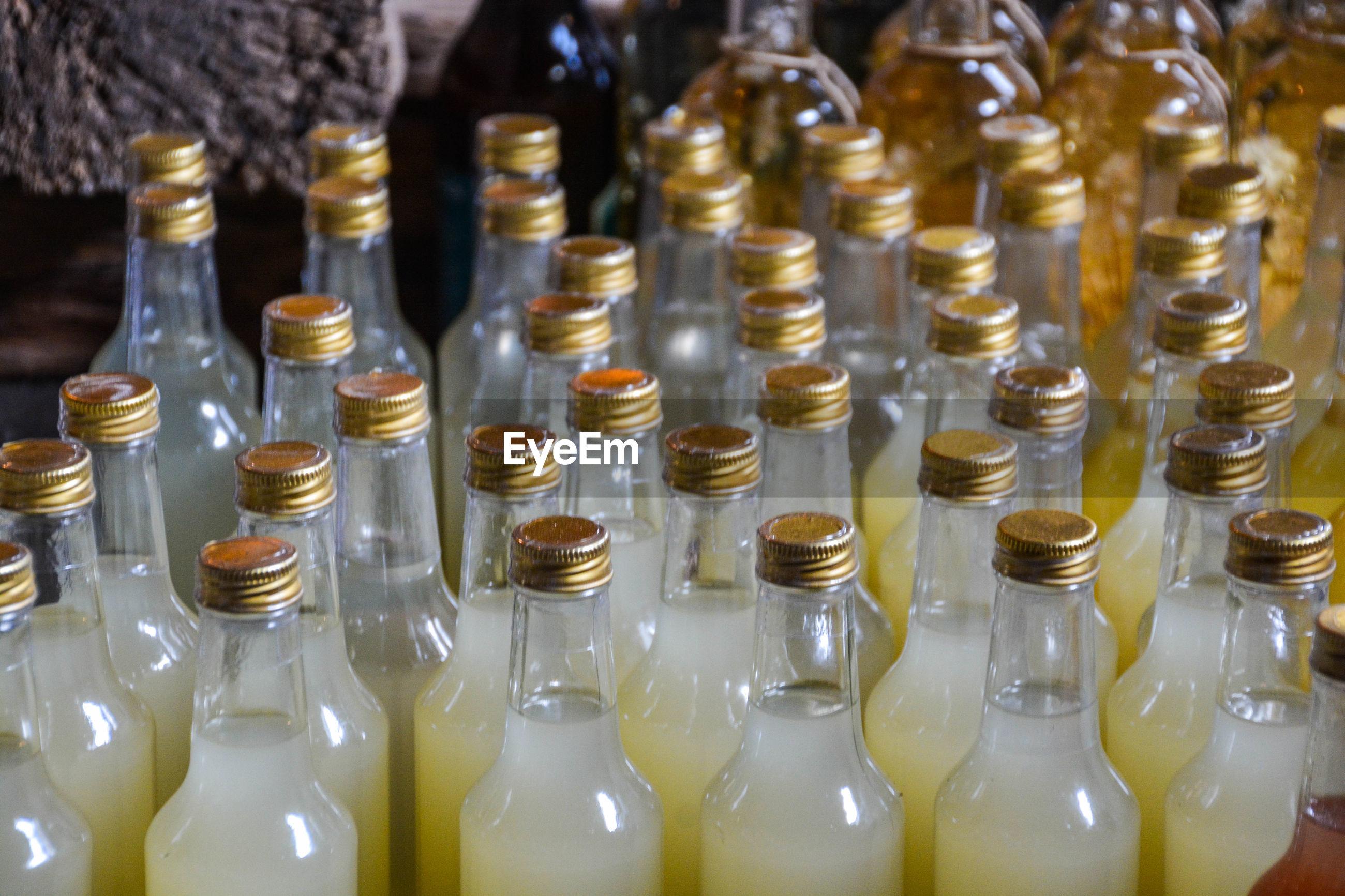 Close-up of liquid in bottles