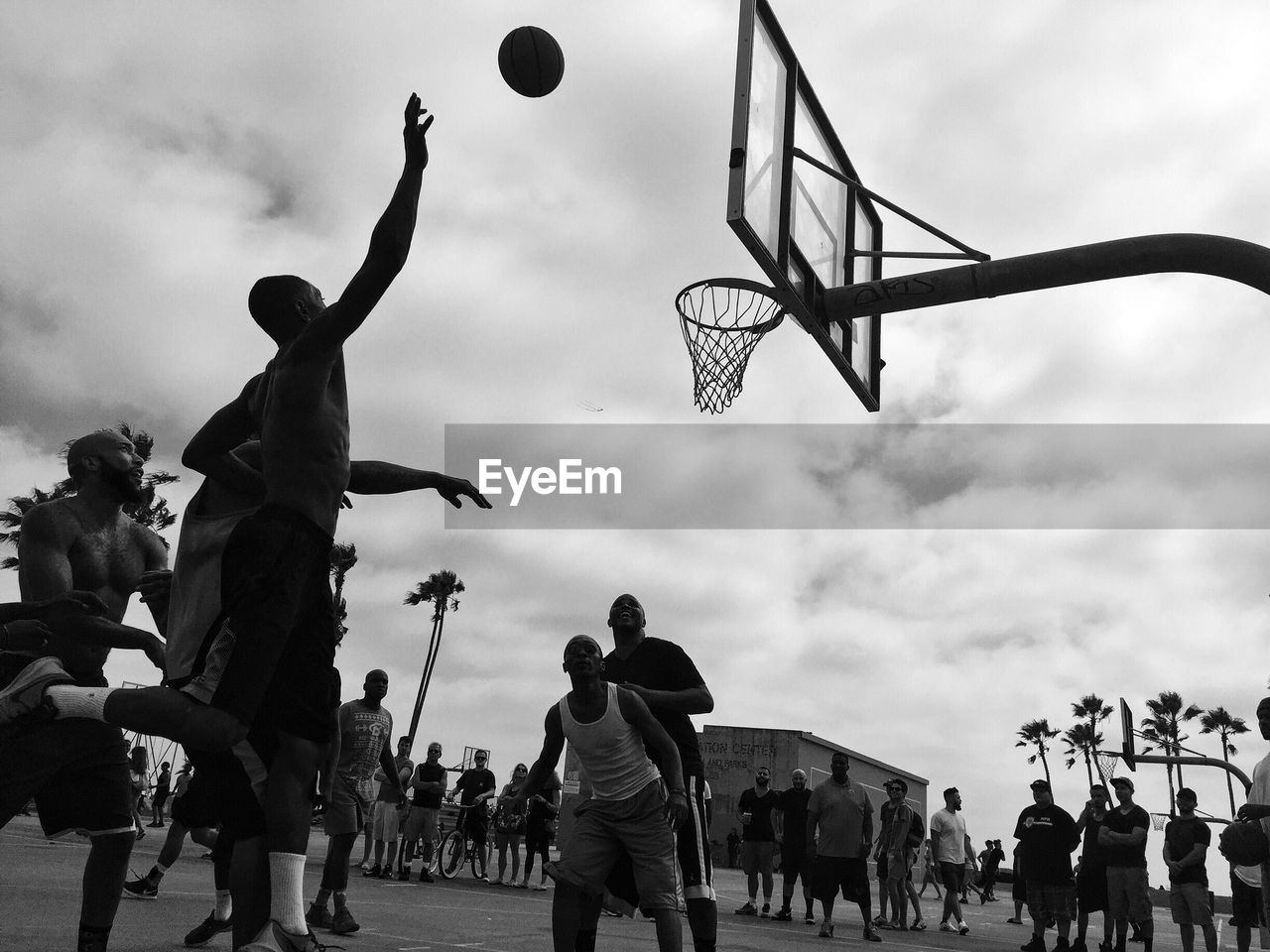 basketball - sport, basketball hoop, basketball player, sport, playing, men, taking a shot - sport, ball, real people, large group of people, activity, motion, leisure activity, sky, jumping, court, lifestyles, outdoors, competition, day, sportsman, people, adult