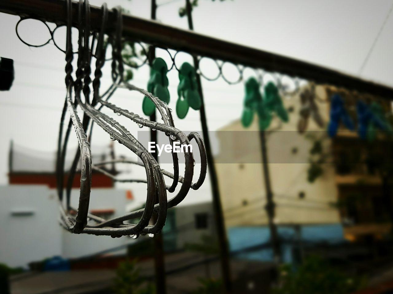 Wet Hangers Hanging On Rod