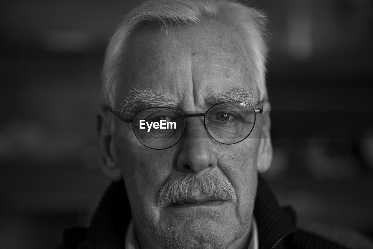 Close-up portrait of man wearing eyeglasses