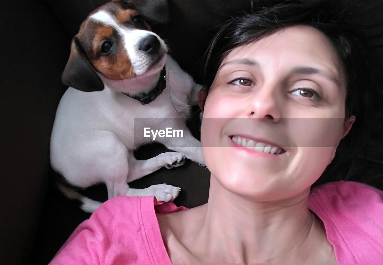 pets, dog, one animal, domestic animals, pet owner, mammal, one person, real people, young adult, looking at camera, young women, holding, headshot, leisure activity, indoors, pink color, portrait, puppy, one young woman only, happiness, close-up, day, people