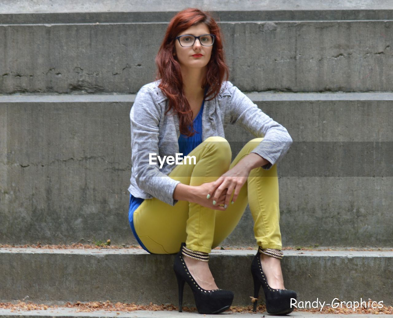 young adult, young women, eyeglasses, one person, sunglasses, fashion, casual clothing, redhead, lifestyles, portrait, full length, real people, leisure activity, looking at camera, outdoors, beautiful woman, day, eyewear, youth culture, beauty, one young woman only, adult, people