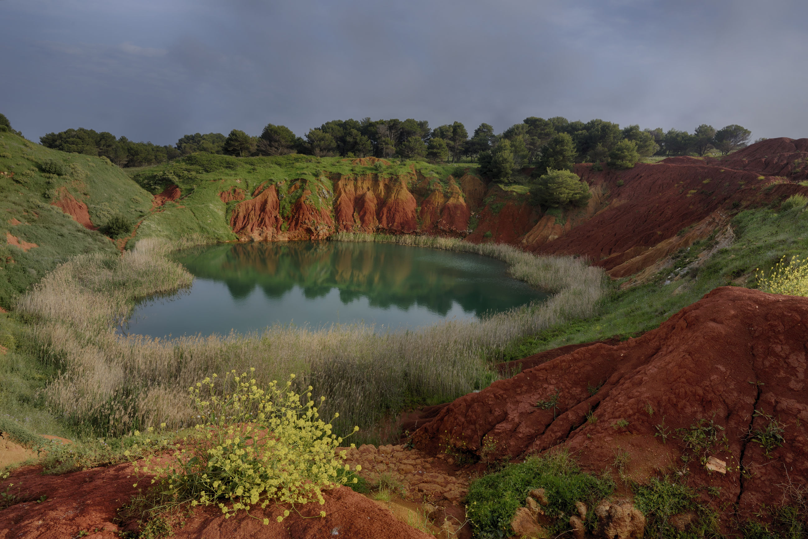Scenic view of pond against cloudy sky