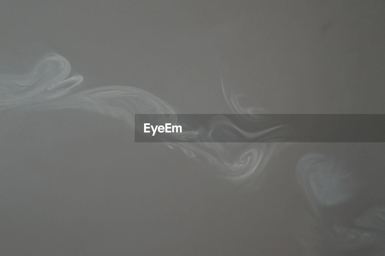 Smoke Against Gray Background