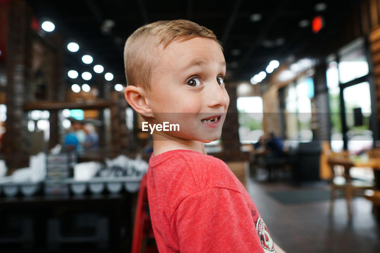 Portrait of smiling boy at restaurant