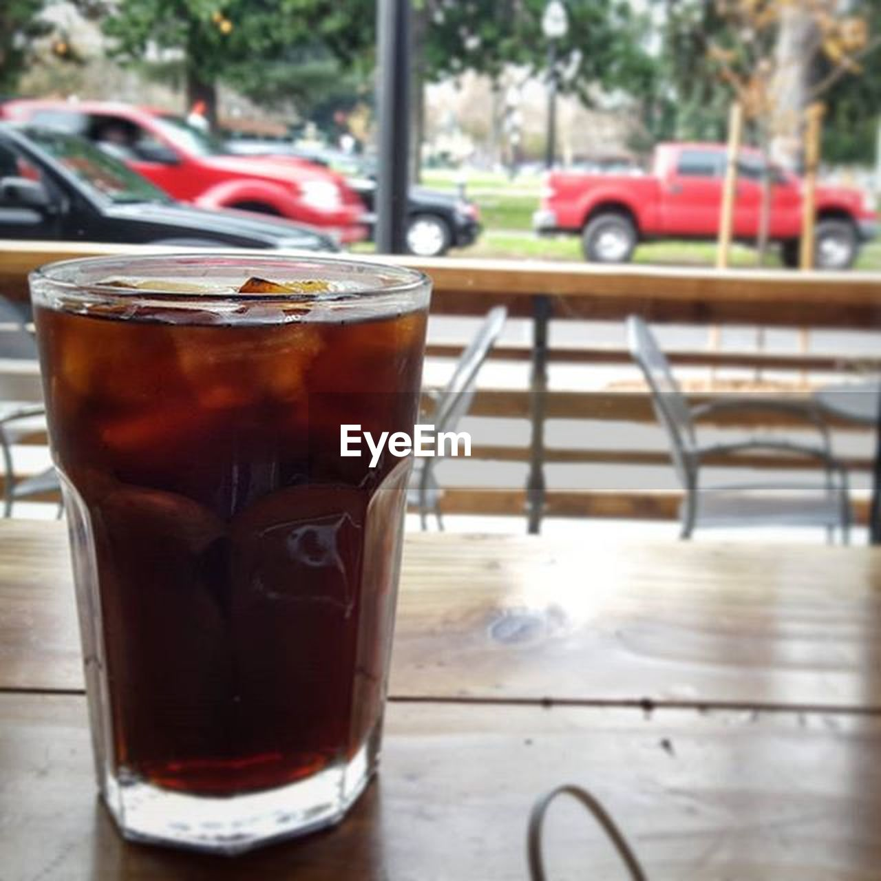 drink, table, food and drink, drinking glass, refreshment, no people, cafe, focus on foreground, day, cold temperature, drinking straw, close-up, ice tea, freshness, iced coffee, outdoors