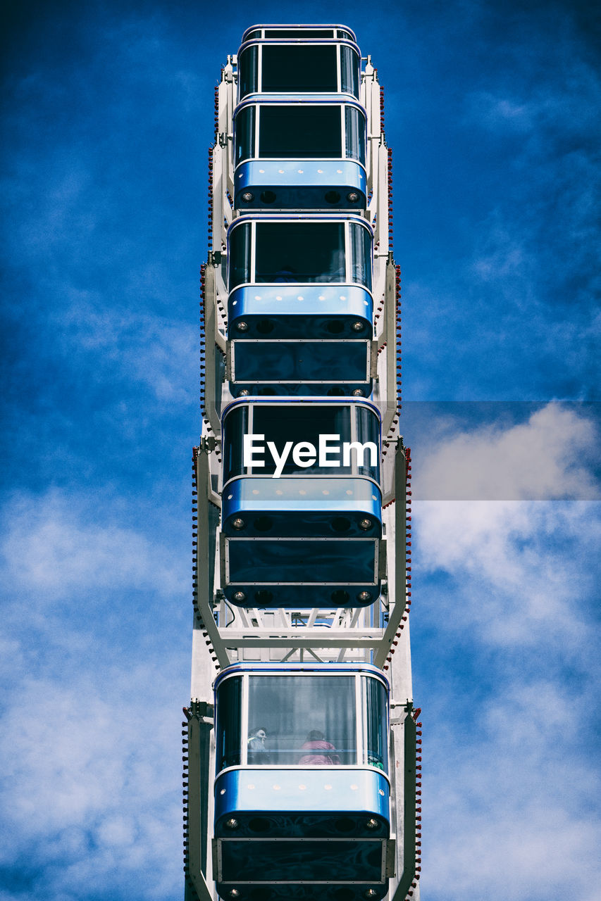 sky, cloud - sky, architecture, built structure, low angle view, no people, building exterior, day, tall - high, blue, building, nature, tower, outdoors, pattern, sunlight, travel destinations, skyscraper, amusement park, apartment