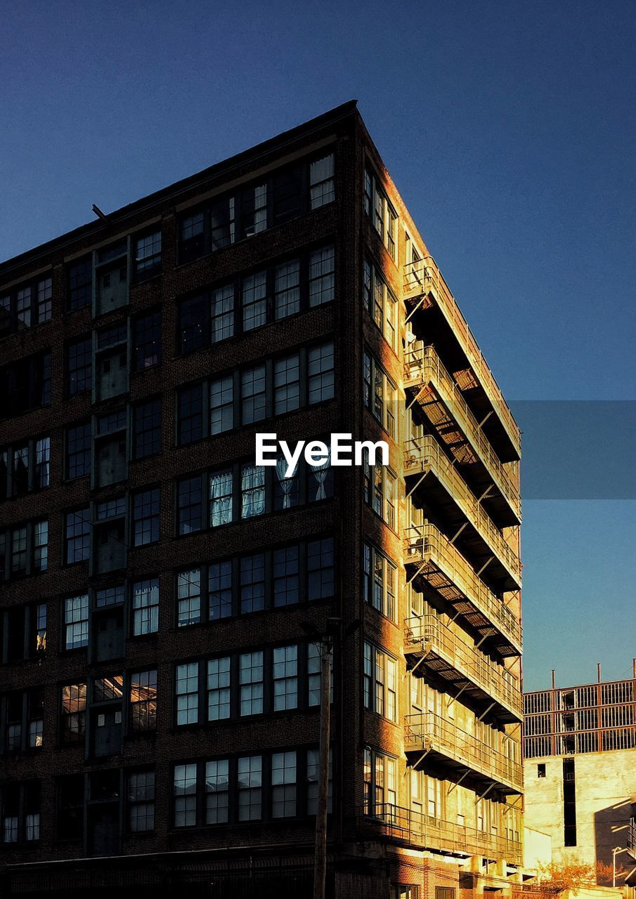 architecture, building exterior, built structure, low angle view, window, clear sky, no people, outdoors, day, sky, modern