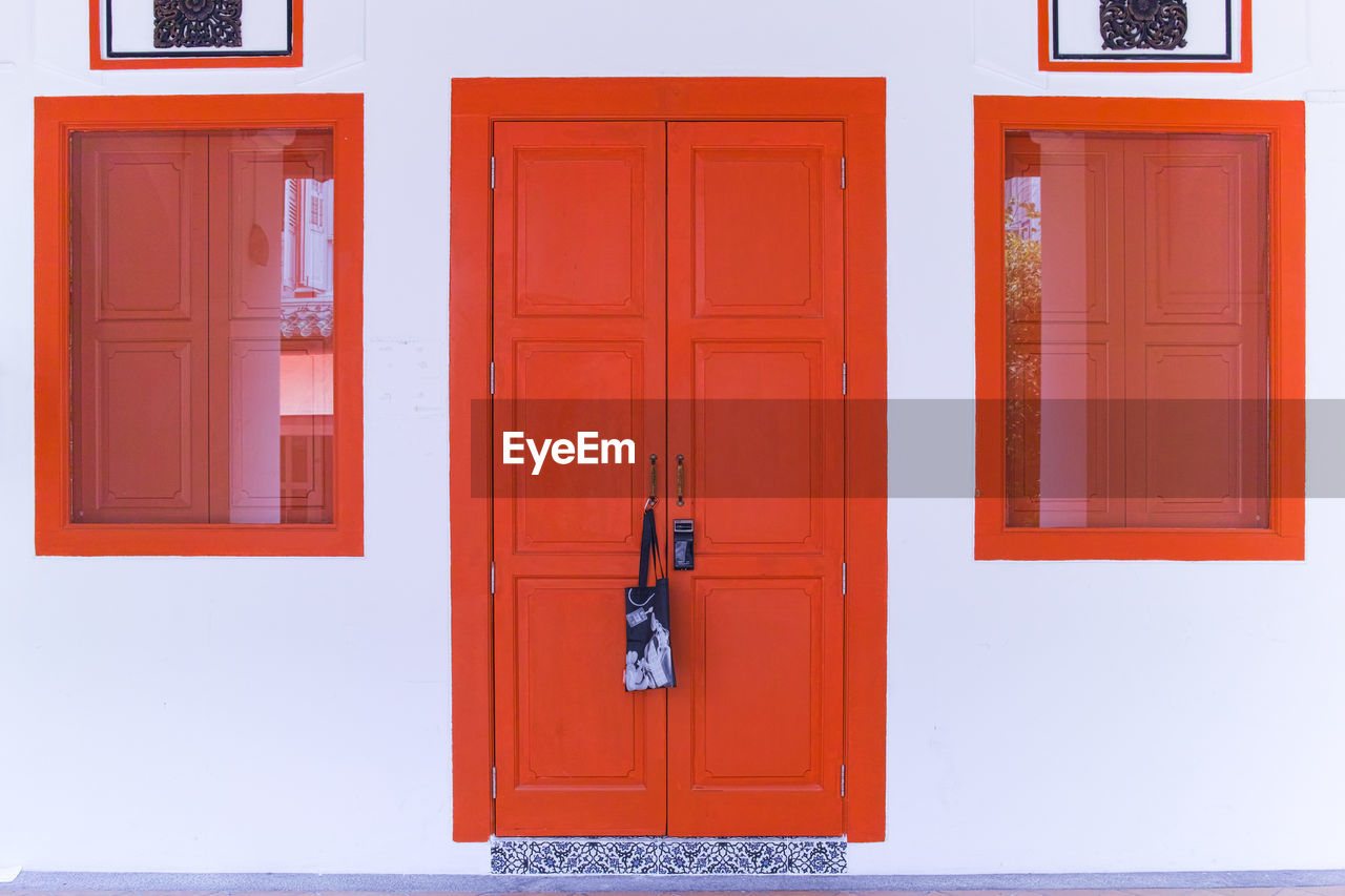 door, entrance, safety, security, closed, architecture, protection, building exterior, building, built structure, no people, house, wood - material, orange color, day, knob, outdoors, front door, white color, handle