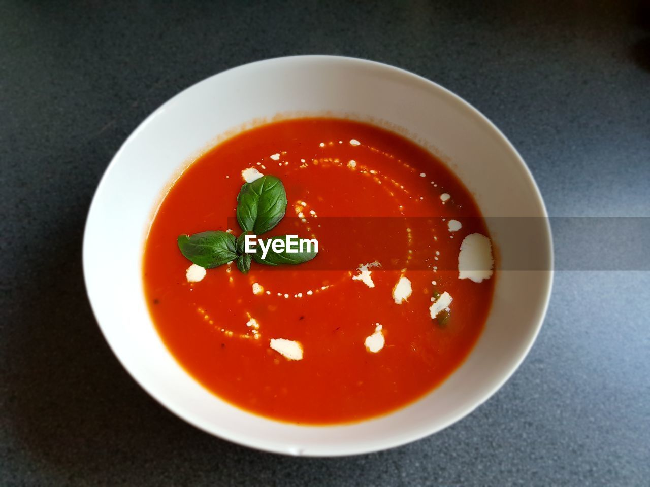 food and drink, food, freshness, still life, tomato, herb, indoors, close-up, table, bowl, red, ready-to-eat, healthy eating, fruit, no people, basil, leaf, soup, wellbeing, garnish, mint leaf - culinary, tomato sauce, temptation, crockery