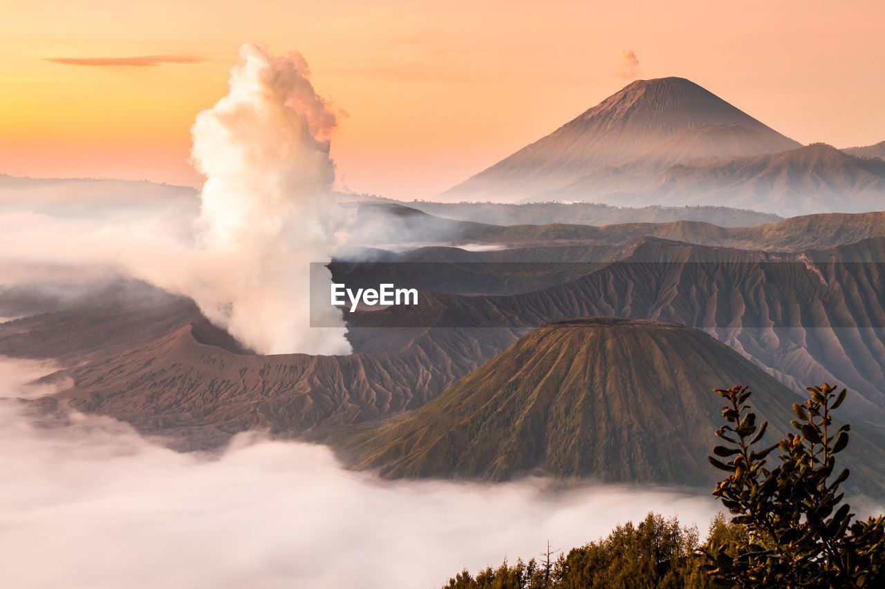 Panoramic View Of Volcanic Landscape Against Sky During Sunset
