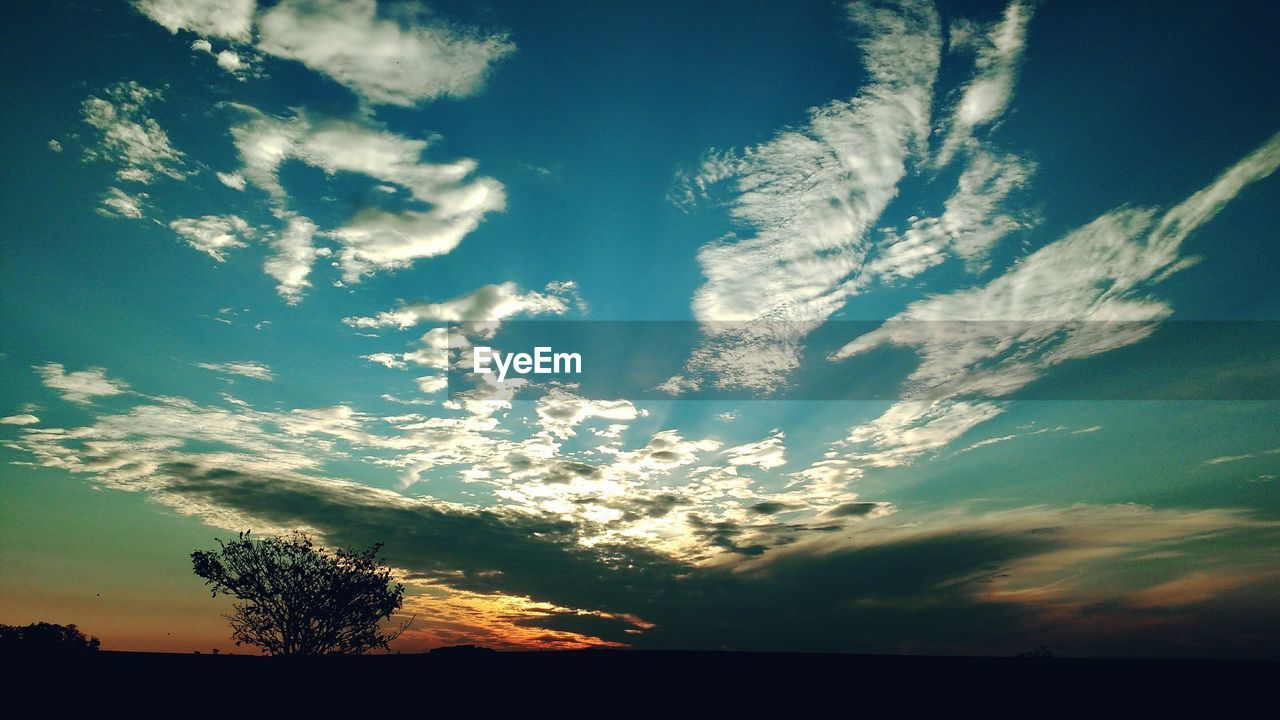 beauty in nature, sky, nature, scenics, tranquil scene, tranquility, cloud - sky, silhouette, sunset, majestic, idyllic, no people, tree, outdoors, low angle view, landscape, awe, day, vapor trail