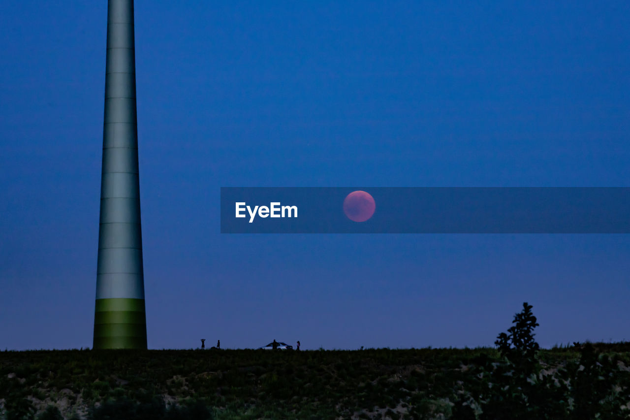 sky, nature, moon, blue, clear sky, scenics - nature, copy space, plant, land, beauty in nature, no people, tranquil scene, low angle view, environment, tranquility, field, tree, outdoors, landscape, astronomy, full moon
