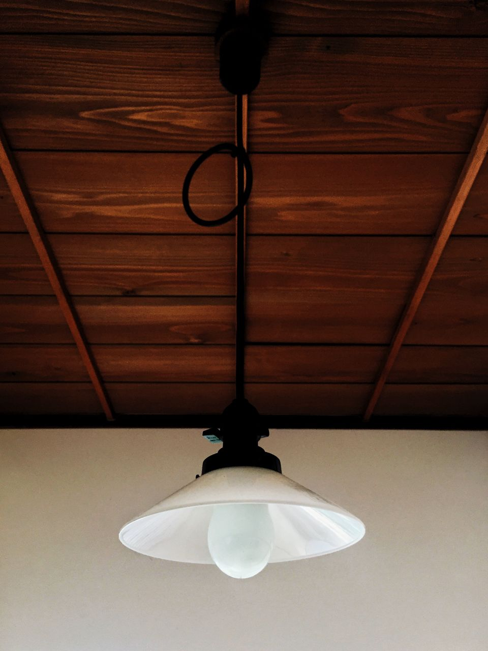 Low Angle View Of Old Lighting Equipment Hanging From Ceiling At Home