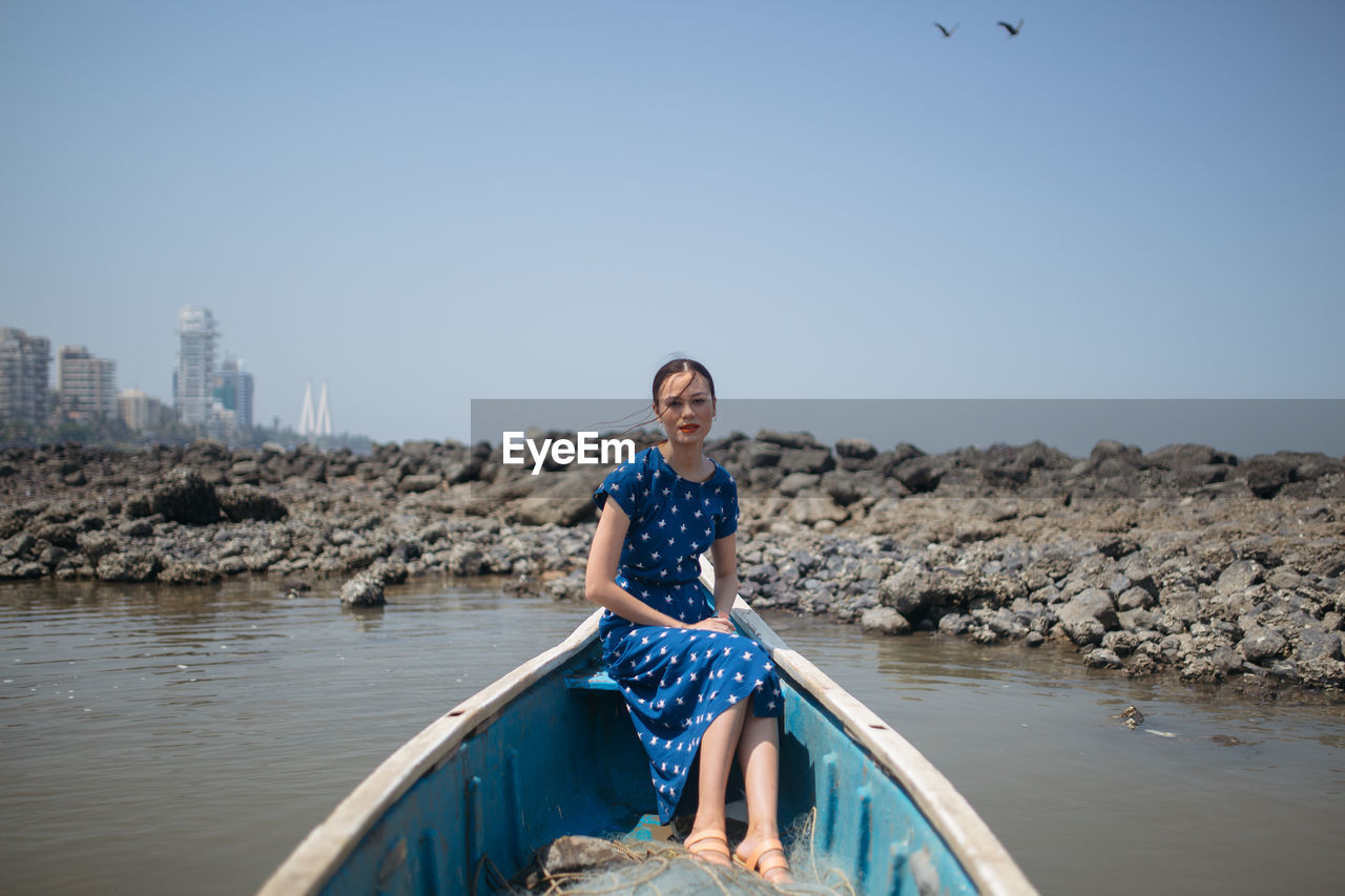 Portrait Of Smiling Young Woman Sitting In Boat