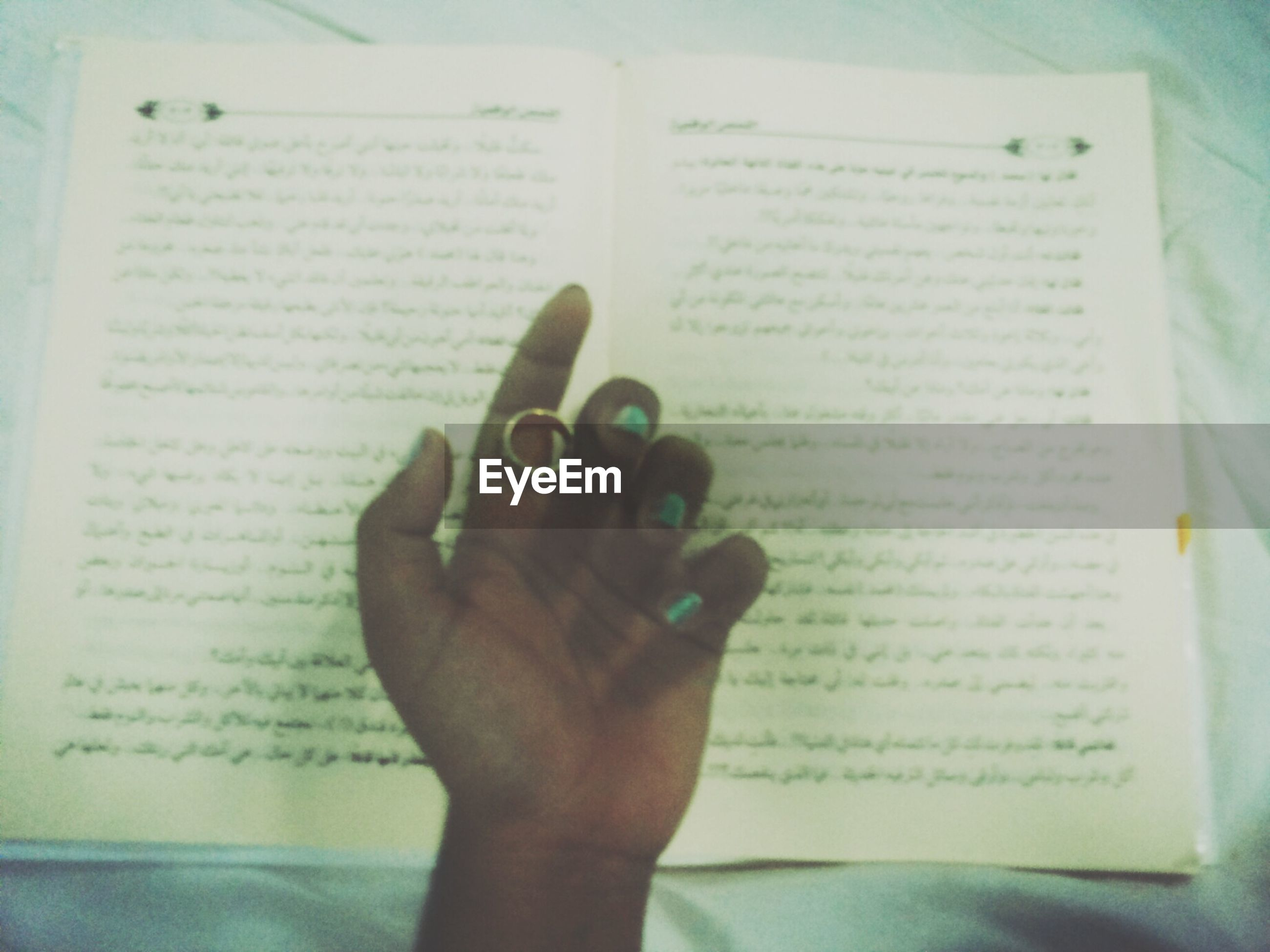 indoors, person, communication, part of, human finger, holding, text, cropped, book, western script, paper, close-up, wireless technology, education, technology, writing, pen
