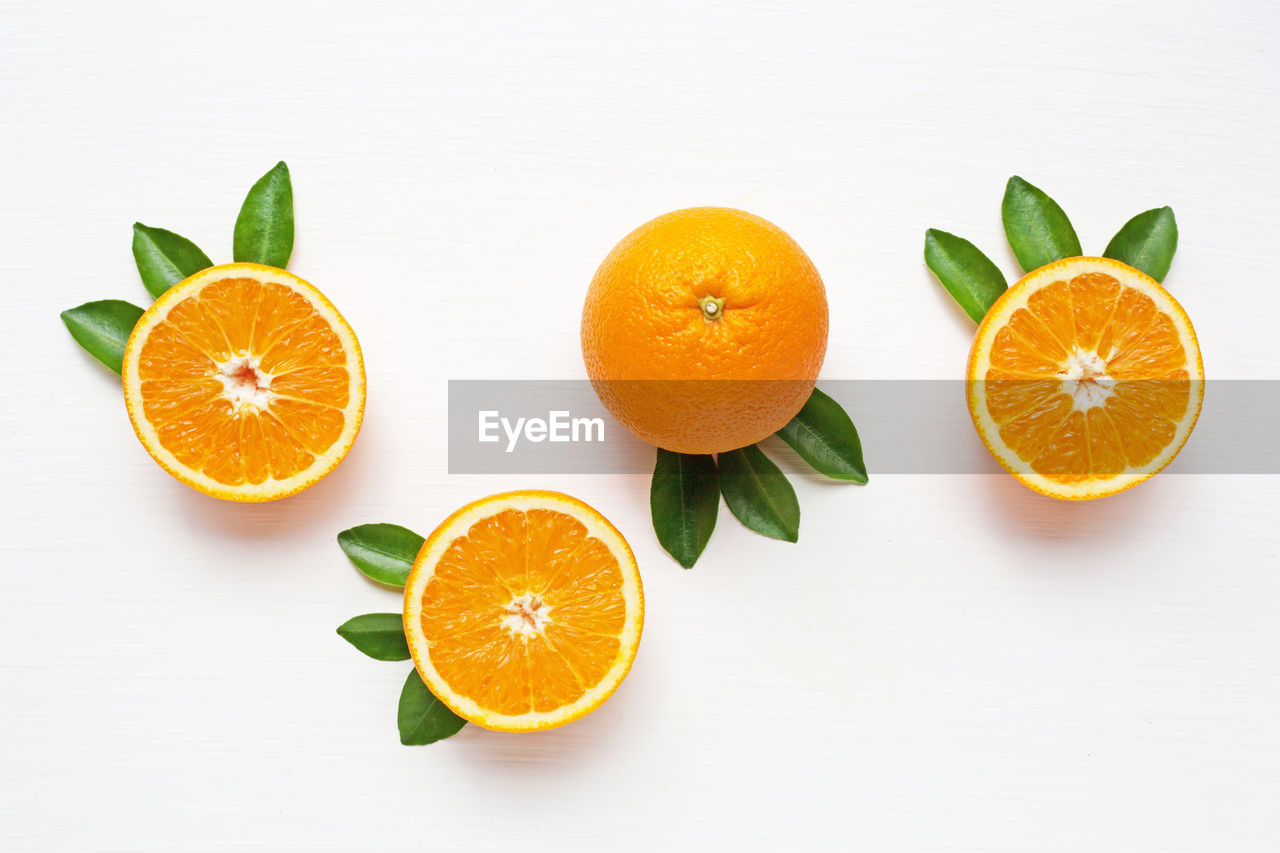 citrus fruit, orange color, fruit, healthy eating, food, orange, food and drink, orange - fruit, wellbeing, white background, studio shot, freshness, leaf, still life, cross section, indoors, plant part, slice, no people, group of objects, small group of objects