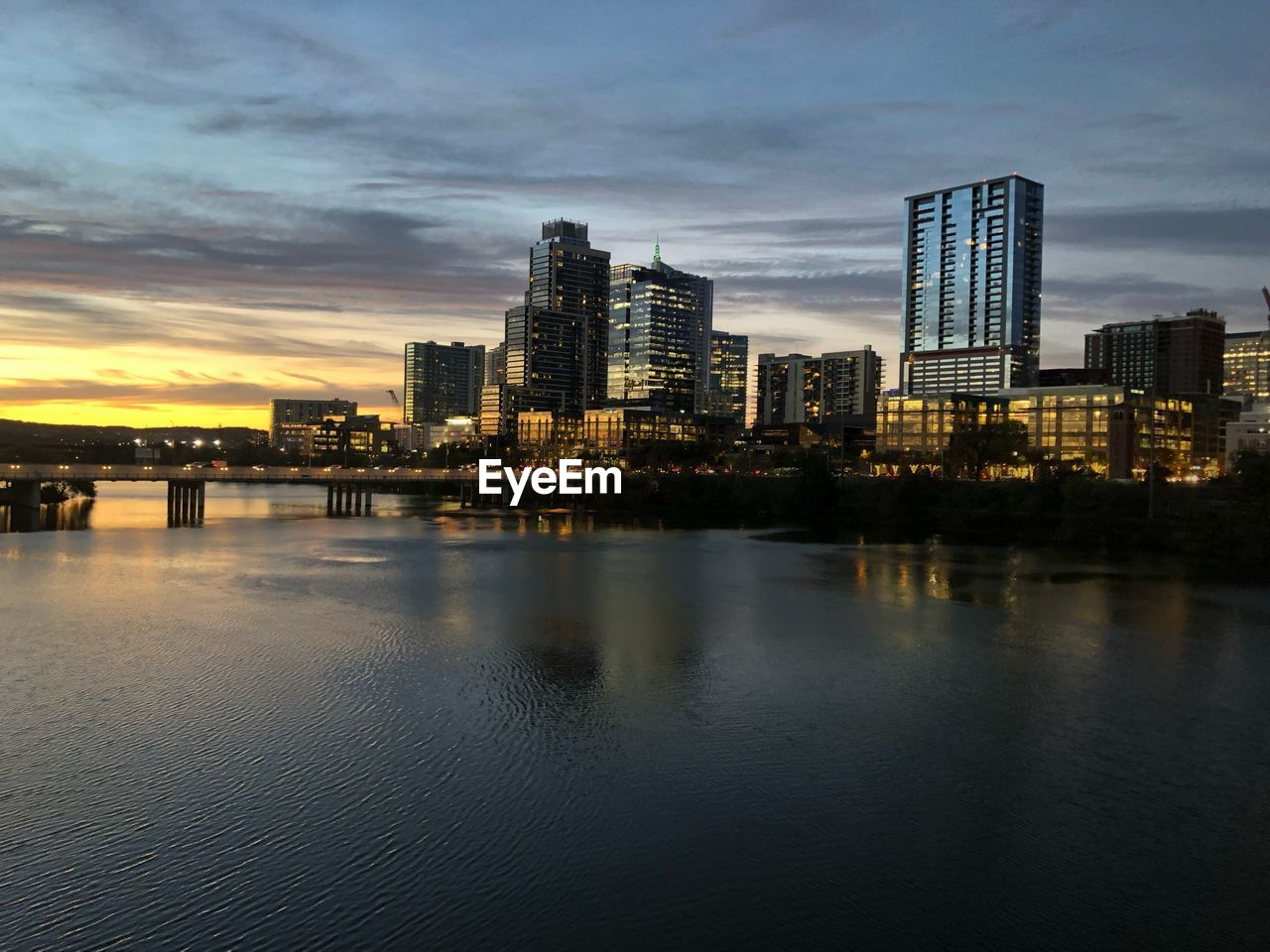 built structure, building exterior, architecture, city, water, sky, waterfront, building, cloud - sky, nature, reflection, no people, sunset, illuminated, office building exterior, cityscape, river, urban skyline, landscape, skyscraper, outdoors, modern, financial district