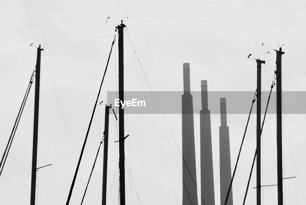 Mast Of Sailboats At Port Against Sky