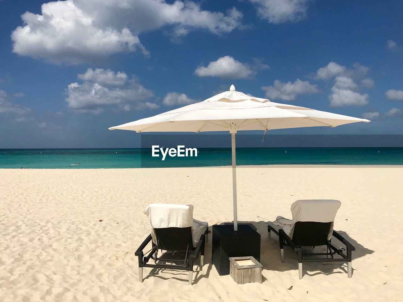 chair, beach, sea, water, sky, land, sand, horizon over water, seat, cloud - sky, sunlight, horizon, scenics - nature, absence, shade, tranquil scene, parasol, nature, umbrella, no people, outdoors