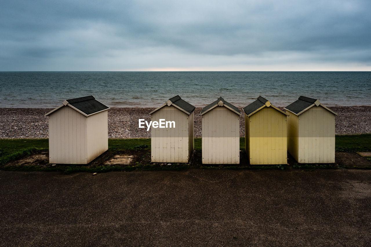 Beach Huts Against Sea