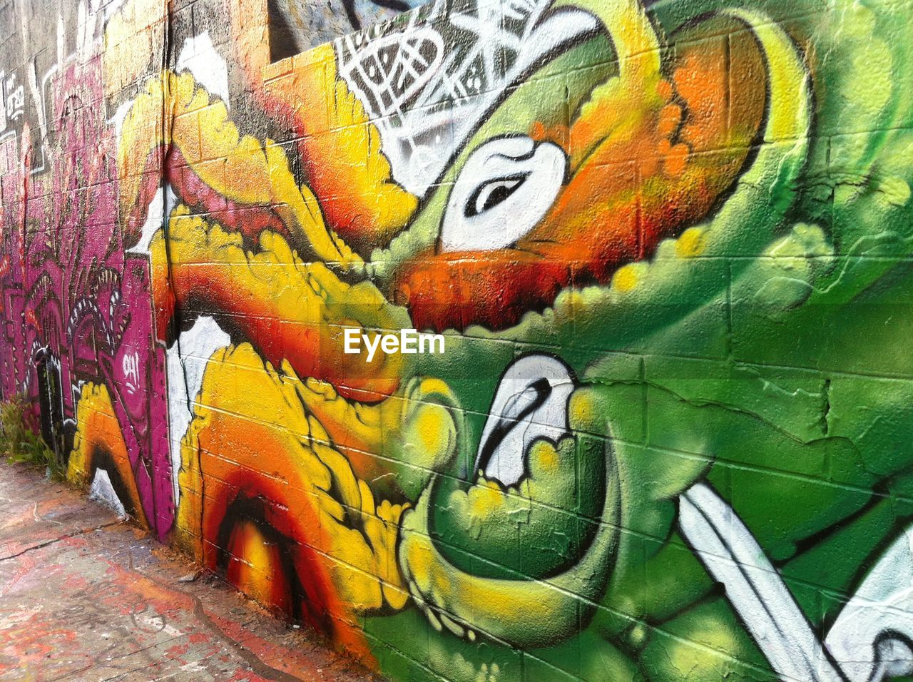 graffiti, art and craft, multi colored, no people, animal themes, close-up, day, animals in the wild, bird, outdoors