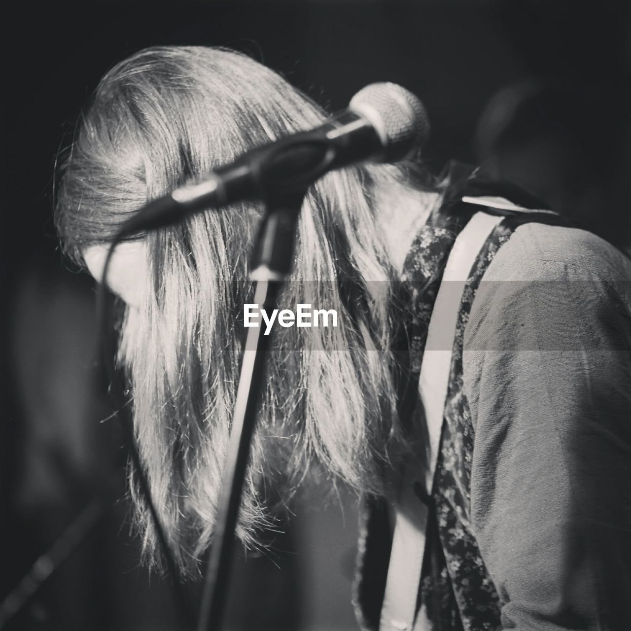 Musician With Long Hair And Microphone