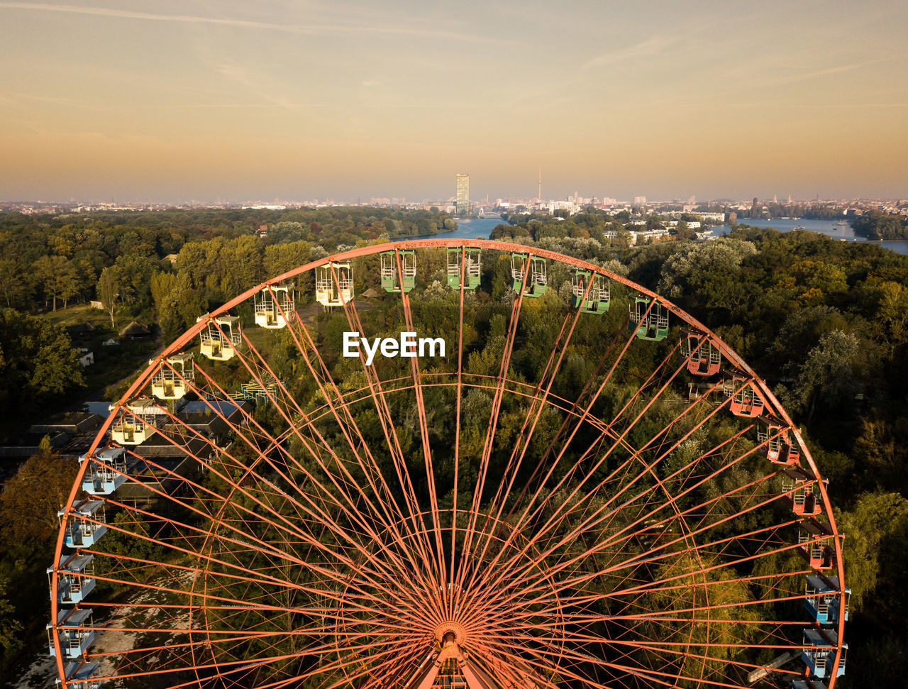 ferris wheel, arts culture and entertainment, cityscape, sky, no people, outdoors, city, building exterior, travel destinations, illuminated, architecture, day