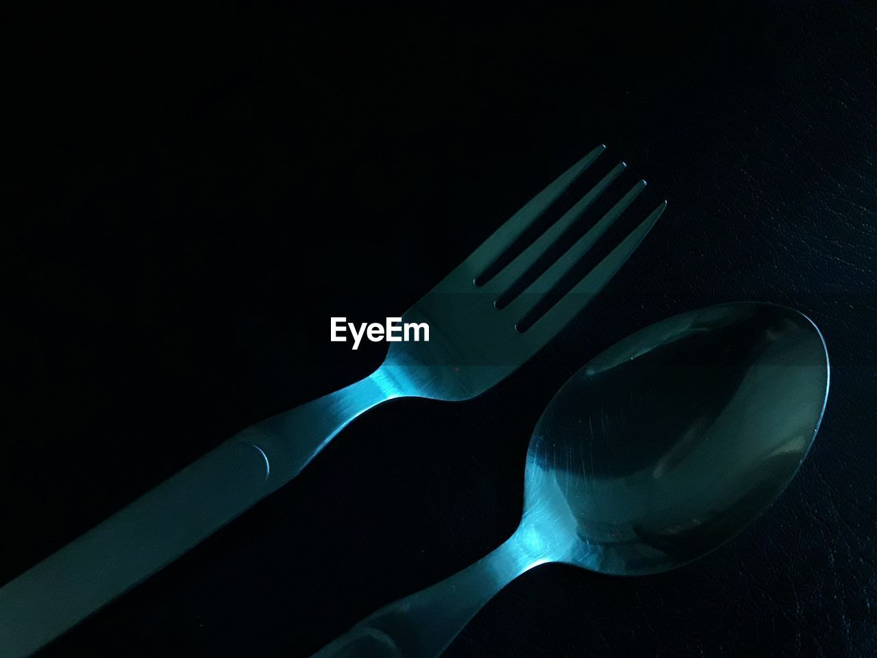 High angle view fork and spoon on black background