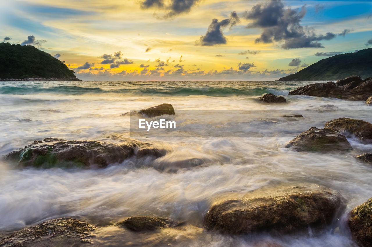 water, sea, beauty in nature, sky, scenics - nature, rock, cloud - sky, sunset, solid, motion, rock - object, beach, idyllic, tranquil scene, nature, long exposure, tranquility, no people, land, horizon over water, outdoors, flowing water