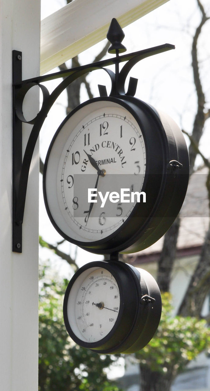 time, number, day, close-up, focus on foreground, gauge, clock, no people, low angle view, hanging, outdoors, technology, minute hand, pressure gauge, clock face