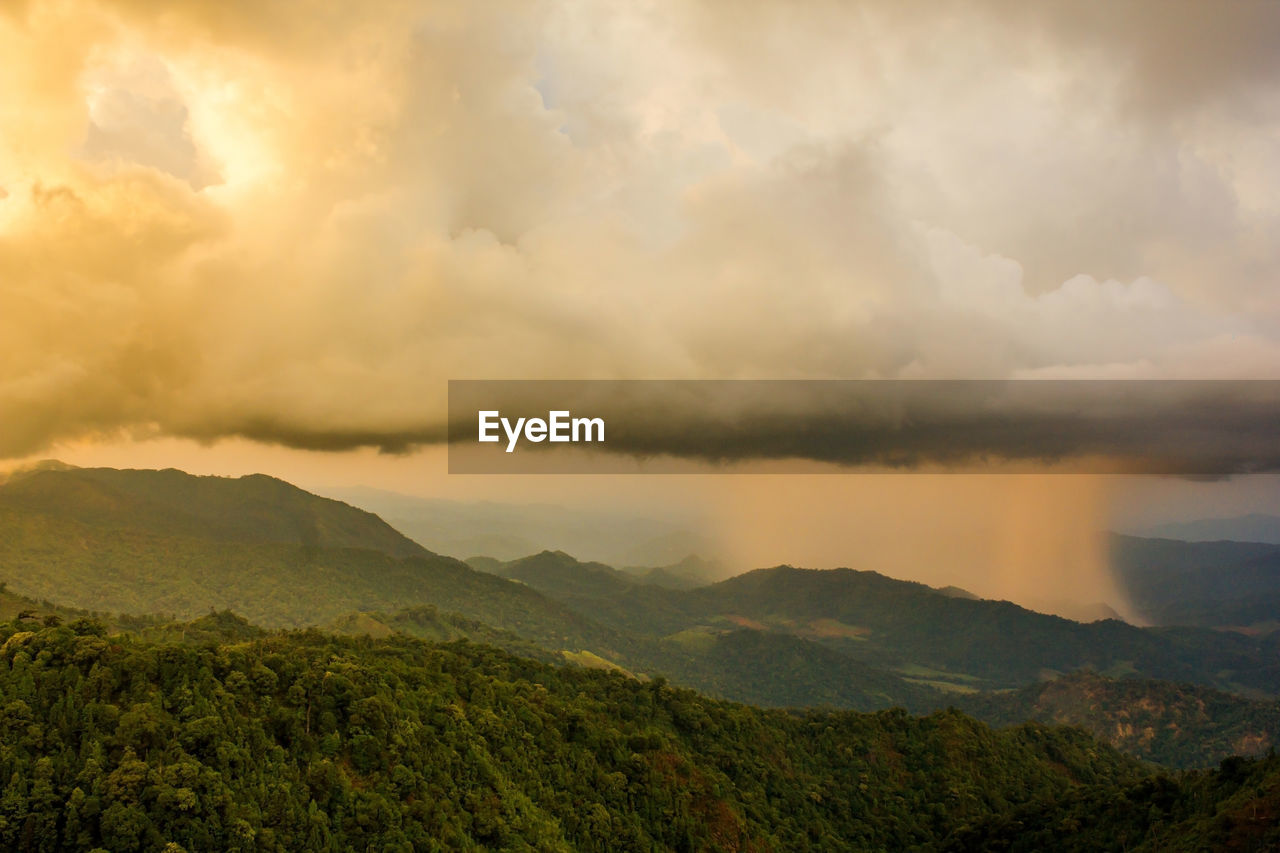 nature, scenics, tranquility, beauty in nature, tranquil scene, cloud - sky, landscape, mountain, no people, idyllic, sky, outdoors, sunset, mountain range, day, storm cloud