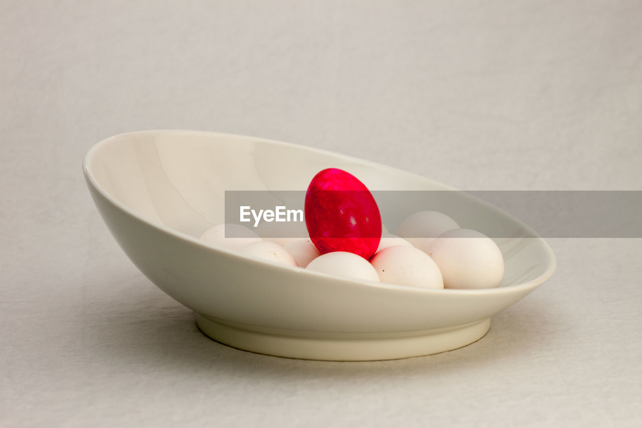 food, red, bowl, food and drink, indoors, still life, close-up, wellbeing, freshness, table, white color, no people, healthy eating, fruit, high angle view, studio shot, indulgence, sweet food, white background, temptation