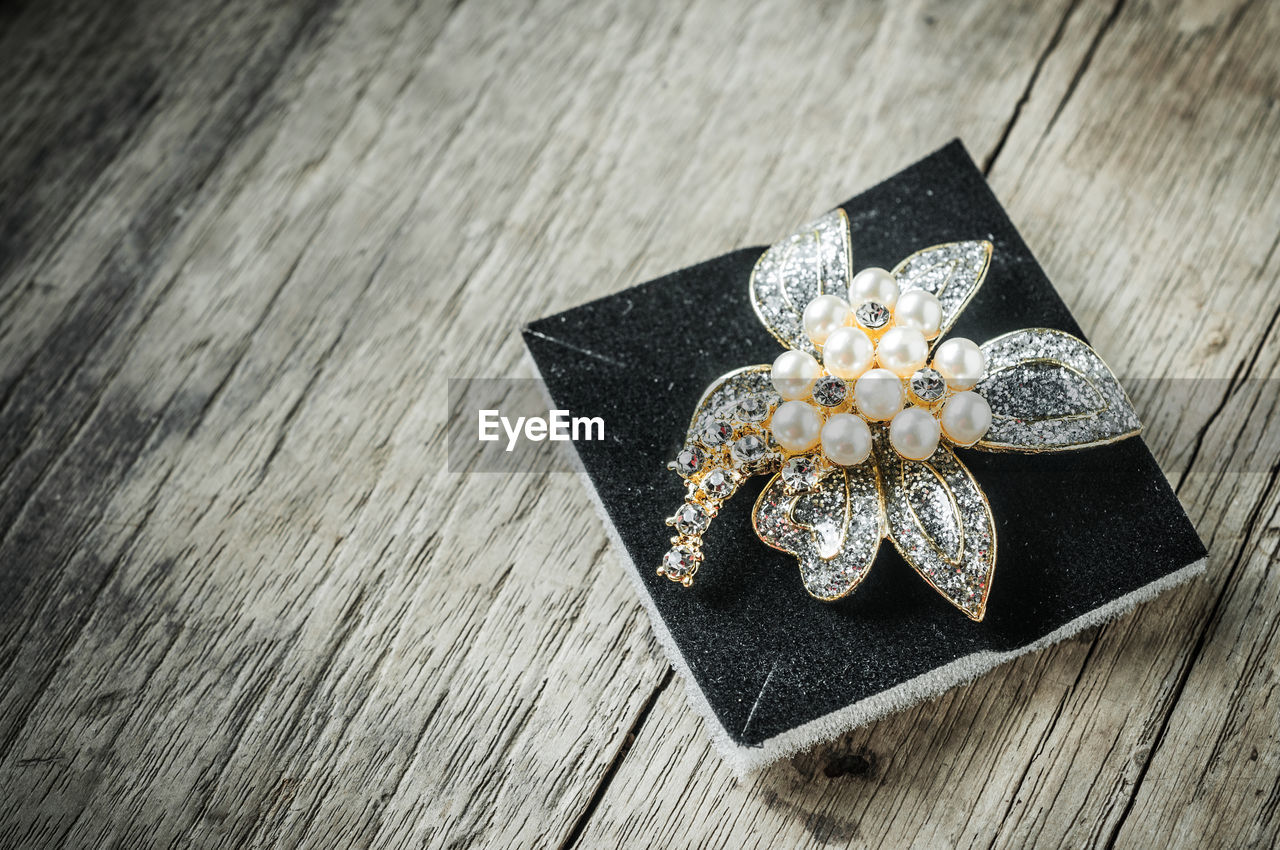 Close-Up Of Diamond Jewelry With Sponge On Table