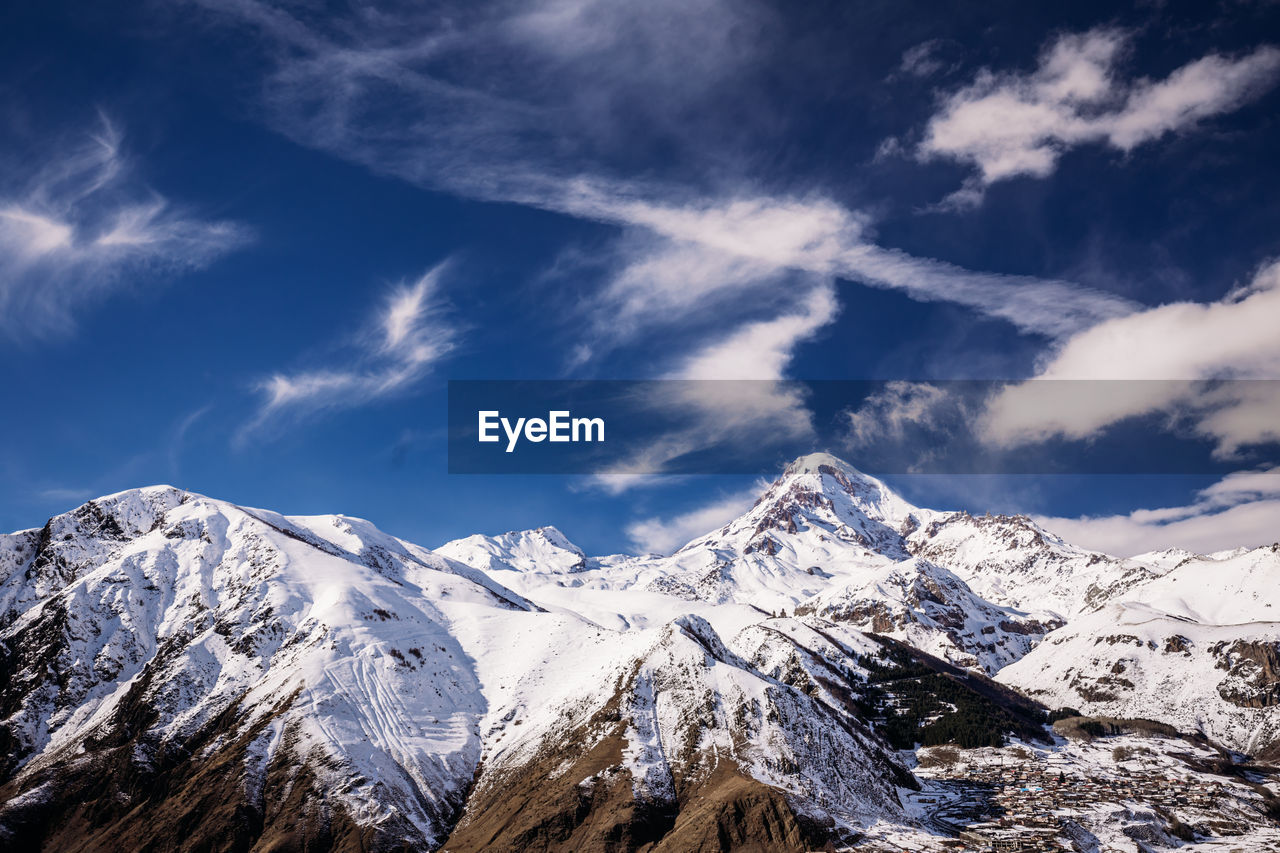 cloud - sky, mountain, snow, winter, sky, beauty in nature, cold temperature, scenics - nature, mountain range, snowcapped mountain, tranquil scene, tranquility, environment, non-urban scene, day, nature, no people, landscape, white color, mountain peak, extreme weather, formation