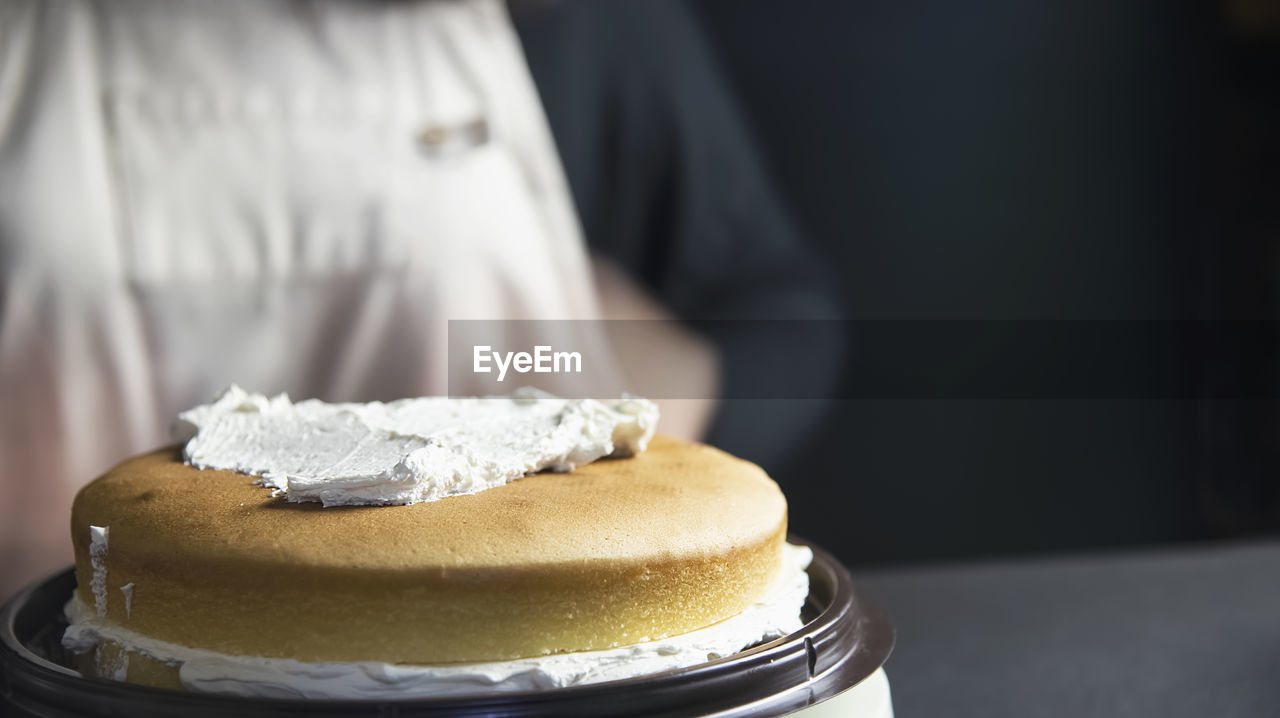CLOSE-UP OF CAKE WITH ICE CREAM