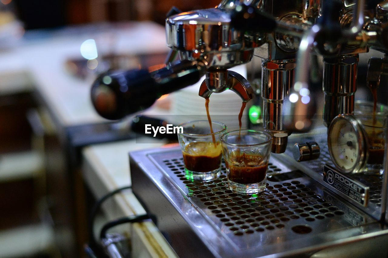 drink, food and drink, refreshment, coffee maker, machinery, appliance, espresso maker, pouring, coffee, coffee - drink, selective focus, indoors, cafe, close-up, making, preparation, alcohol, metal, no people, coffee shop, glass, bar counter