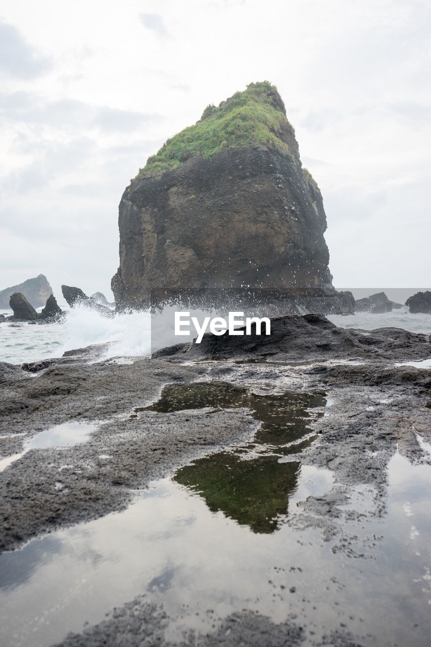 water, sky, rock, beauty in nature, scenics - nature, sea, land, nature, rock - object, solid, cloud - sky, tranquility, tranquil scene, rock formation, no people, motion, day, beach, idyllic, outdoors, power in nature