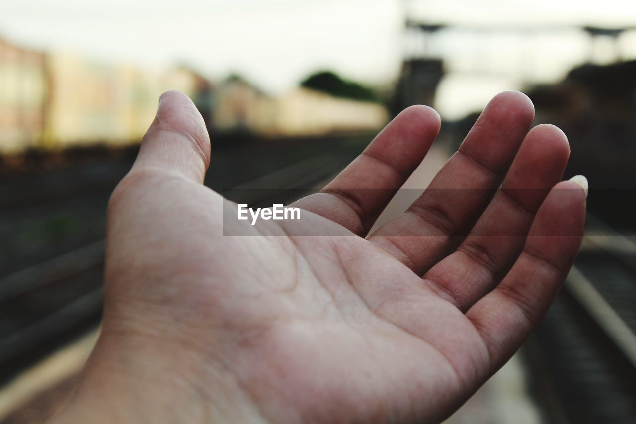 human hand, hand, human body part, real people, one person, body part, human finger, finger, focus on foreground, close-up, personal perspective, men, unrecognizable person, day, leisure activity, lifestyles, positive emotion, selective focus, human limb, aggression, human foot